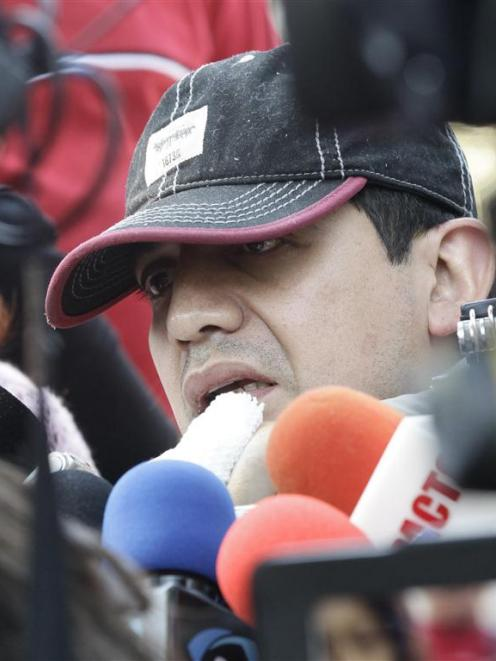 Alfonso Caballero, a Pemex employee injured in the blast, speaks to the media, after he leaves...