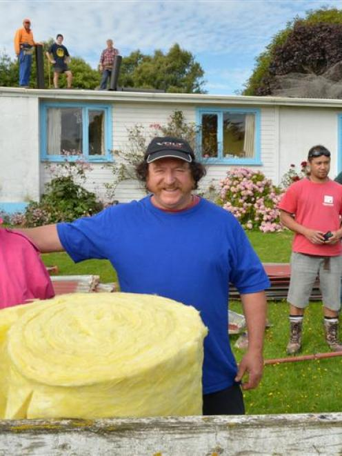 Alison and Peter Appleby (front), in front of their Waitati home, which was recently insulated ...