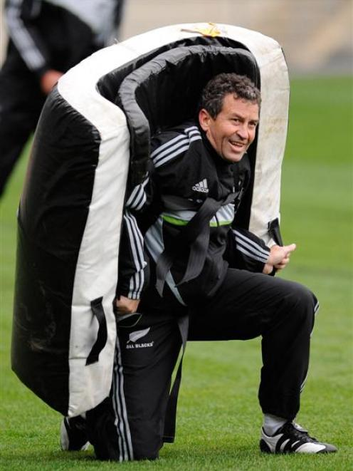 All Black assistant coach Wayne Smith gets involved during a team training session at Carisbrook....