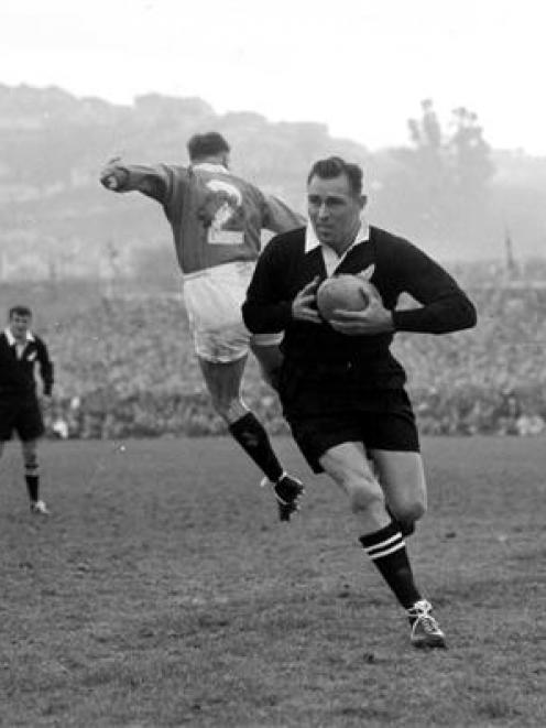 All Black fullback Don Clarke makes a break against the Lions at Carisbrook in 1959. Photo from...