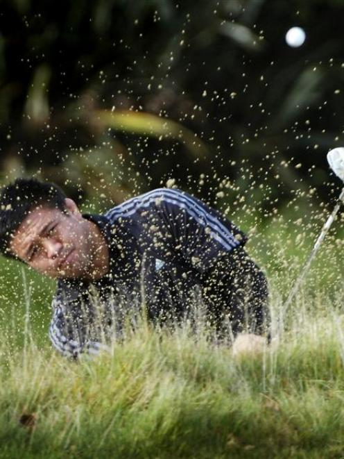 All Black Keven Mealamu shows a delicate touch escaping from a green-side bunker on the fourth...