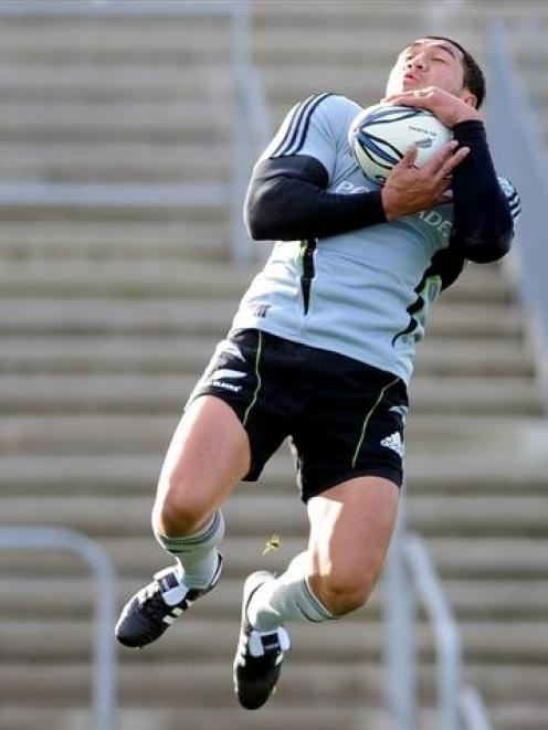 All Black skipper Mils Muliaina goes high to catch the ball at the captain's run at Carisbrook...