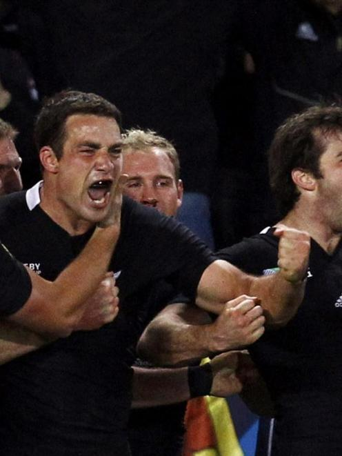 All Blacks (from left) Israel Dagg, Richard Kahui and Conrad Smith celebrate their World Cup...