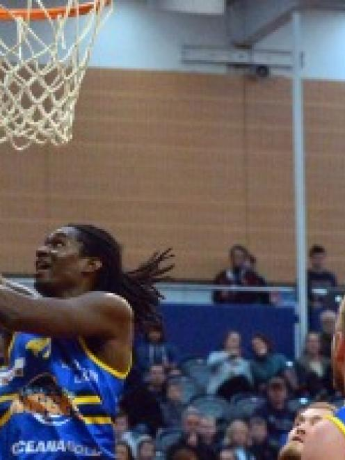Warren Carter he finds the hoop during the Nuggets' match against the  Canterbury Rams at the...