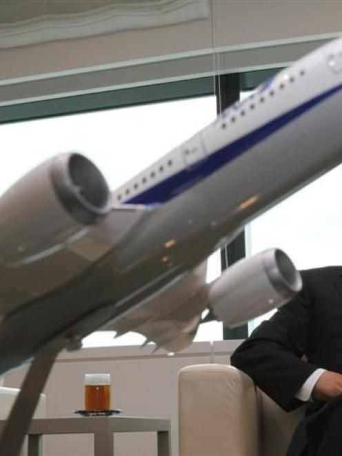All Nippon Airways co-president Shinichiro Ito with a model of Boeing 787 Dreamliner aircraft....