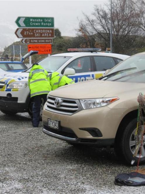 All vehicles,  including police 4WD patrol cars, had to have chains fitted before heading up the...