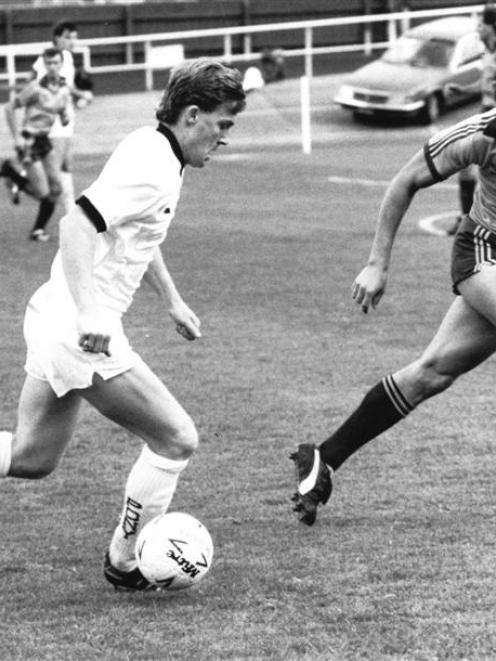 All Whites and Otago stalwart Mike McGarry challenges Australia's Oscar Crino during the match at...