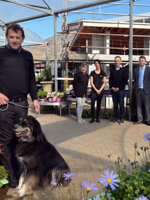 Allan Dippie (left), managing director of Nichol's Garden Group, with dog Ben outside the...