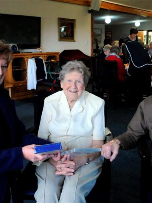 Altrusa Club of Taieri member Glennys Espie (left) with Brooklands Resthome residents Gwenda...