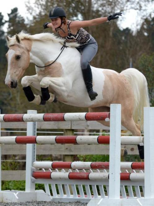 Alycia Burton shows her free riding  skills  on her horse Goldrush at the Waitati Valley...