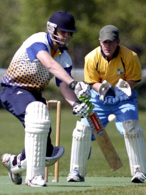 am Wells (Dunedin) chases a delivery as Otago Country wicketkeeper Scott Simpson looks on during...