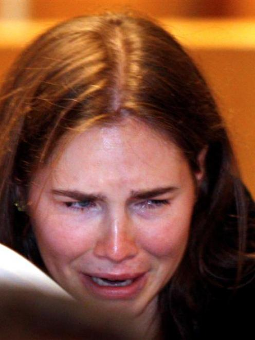 Amanda Knox reacts as she hears that she has been cleared of murder. REUTERS/PierPaolo Cito/Pool