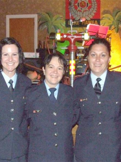 Amber Hollis, Jacqui Read, Tina Gillies, Aubrey Dixon, and Liz Matheson are female firefighters...