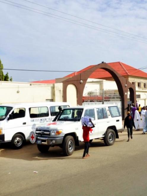 Ambulances and security officers arrive at the Murtala Muhammad hospital after a suicide bomb...