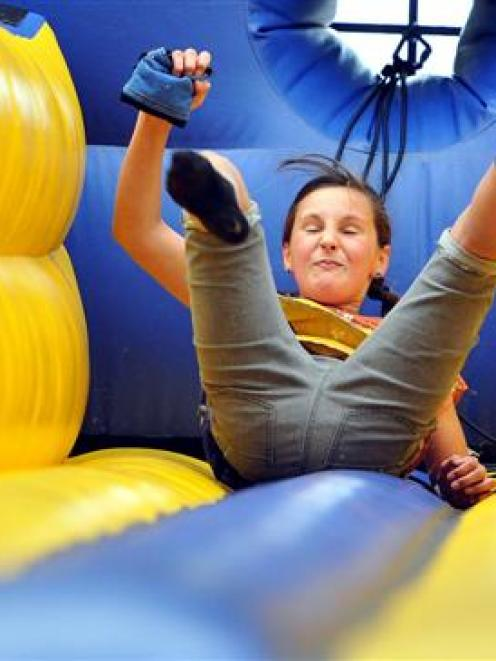 Amelia Eady (10), of Dunedin, takes a tumble on an inflated bungee run at the Edgar Centre. Photo...