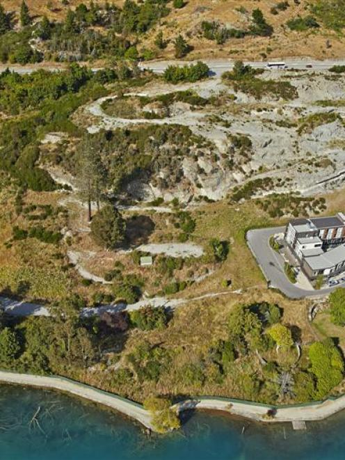 An aerial photograph showing Lake's Edge, an undeveloped 4ha site on the shore of Lake Wakatipu...
