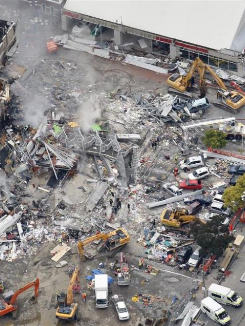 An aerial view of emergency services working at the ruined CTV building in central Christchurch....