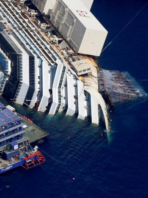An aerial view shows the Costa Concordia lying on its side next to Giglio Island. REUTERS...