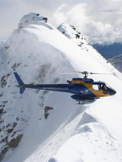 An Alpine Heliski Ltd chopper sits atop Temple Peak, near Glenorchy, in April this year. The...