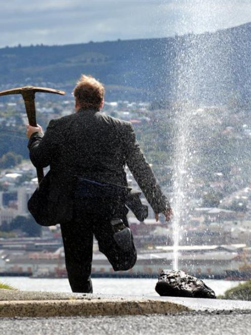 An angry ratepayer destroys his recently installed water meter after learning of Dunedin City...