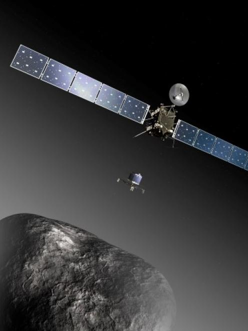An artist's impression shows the Rosetta orbiter deploying the Philae lander to comet 67P...