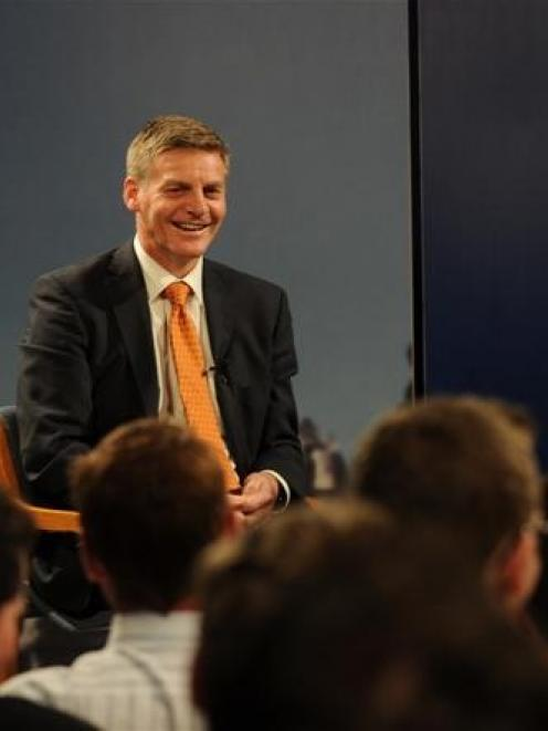 An audience member asks a question of Finance Minister Bill English. Photo by Peter McIntosh.