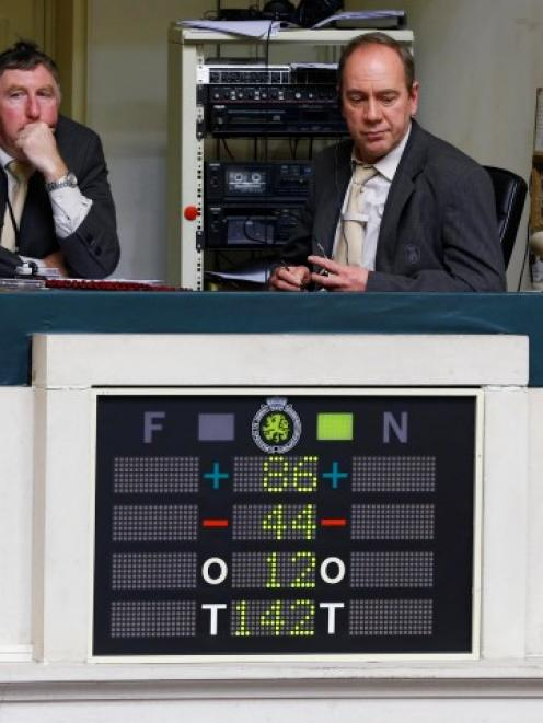 An electronic voting board shows the results of a vote on a law to allow euthanasia for...