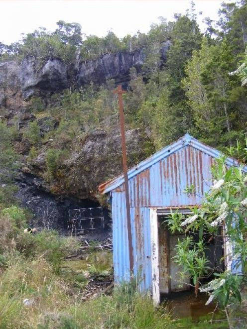 An entrance to a  historical  underground coal mine on the  Denniston Plateau escarpment, which...