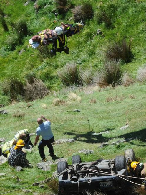 An injured man is winched to safety by the Otago Regional Rescue Helicopter. Photo by Craig Baxter