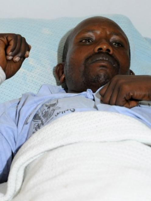 An injured policeman rests in a hospital bed in Kenya's capital Nairobi following an ambush in...