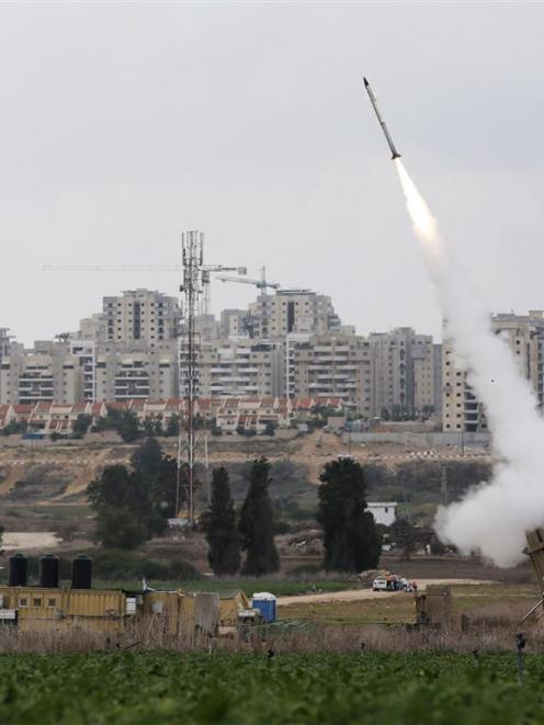 An Iron Dome launcher fires an interceptor rocket near the Israeli city of Ashkelon. REUTERS...