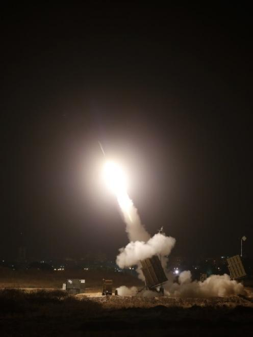 An Iron Dome launcher fires an interceptor rocket in the southern Israeli city of Ashdod. Photo...