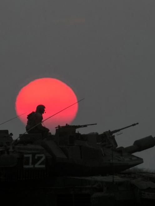 An Israeli tank manoeuvres outside the northern Gaza Strip. REUTERS/Baz Ratner