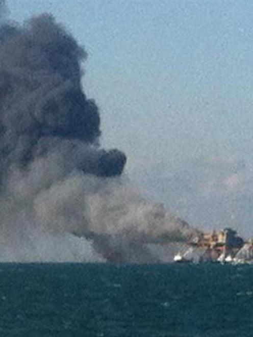 An offshore oil platform burns in the Gulf of Mexico, off the coast of Louisiana, in this image...