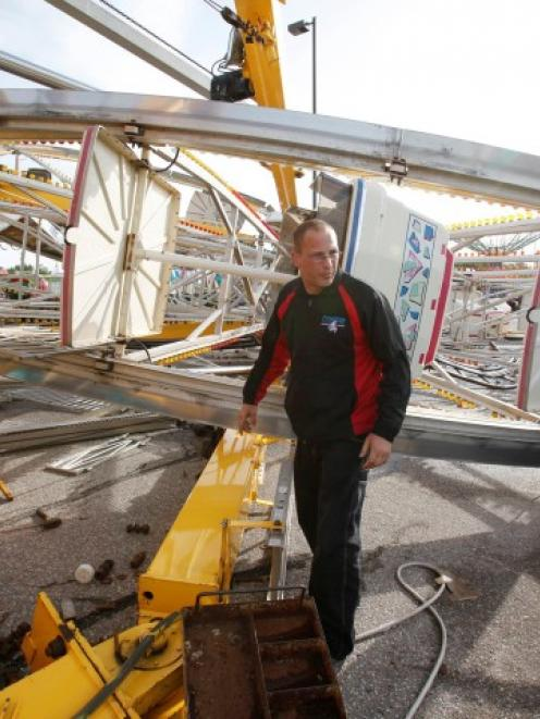 An Ottaway Amusement employee walks around the Century Wheel in Wichita, Kansas. The Ferris wheel...