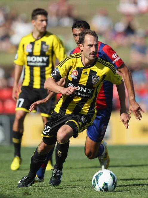 Andrew Durante of the Phoenix on the ball against the Newcastle Jets.  (Photo by Tony Feder/Getty...