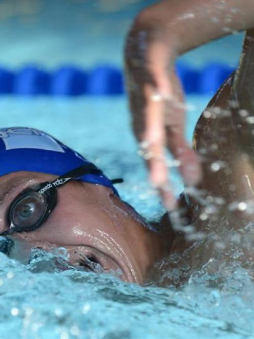 Andrew Trembath (Neptune) wins his heat of the 1500m freestyle at the Otago swimming...