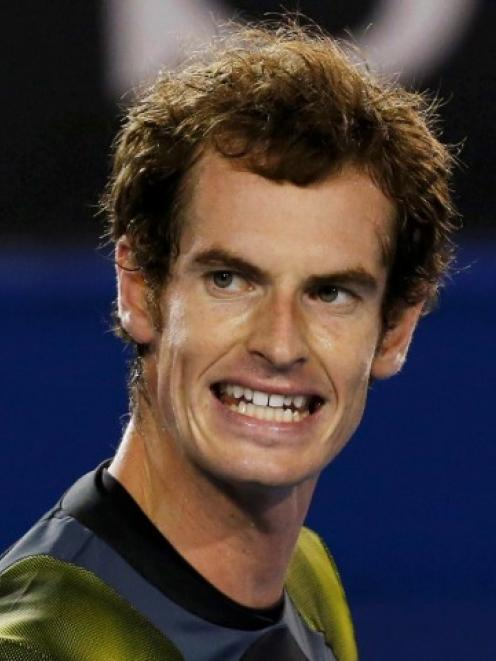Andy Murray of Britain reacts during his men's singles semi-final match against Roger Federer of...