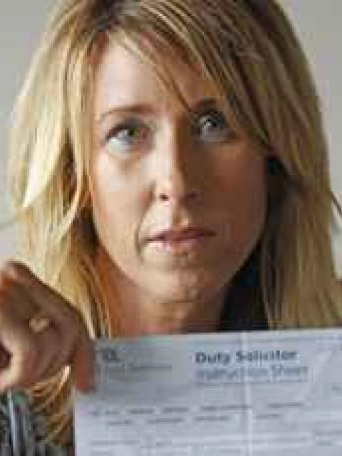 Angela Hughes with the wrongly dated official document that resulted in her being locked in a...