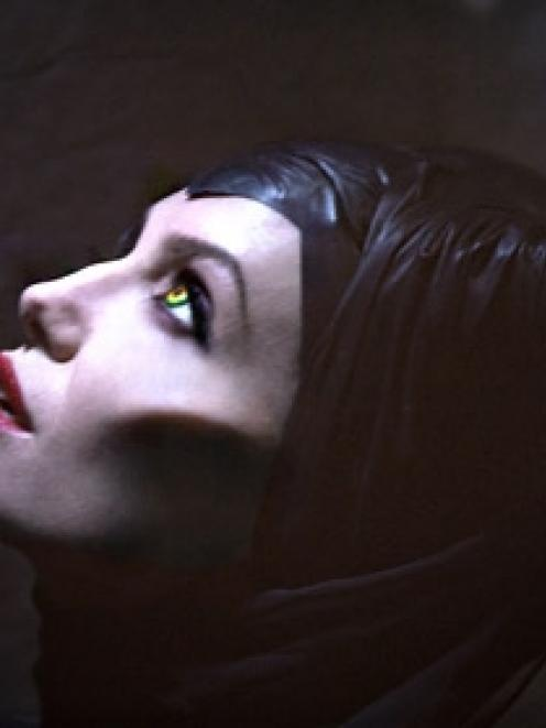 Angelina Jolie as Maleificent.