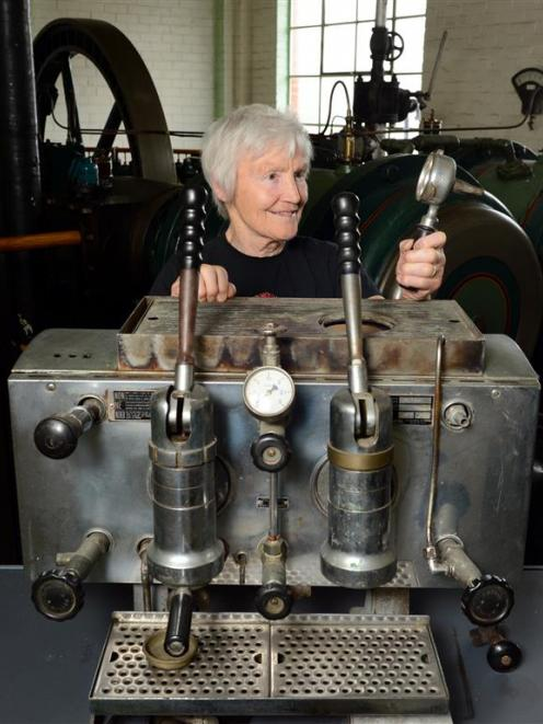 Ann Barsby with what could be Dunedin's first espresso machine. Photo by Gerard O'Brien.