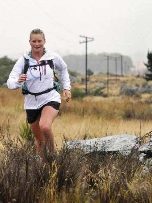 Anna Frost runs near Middlemarch yesterday on her cross-country journey to Dunedin. Photo by...