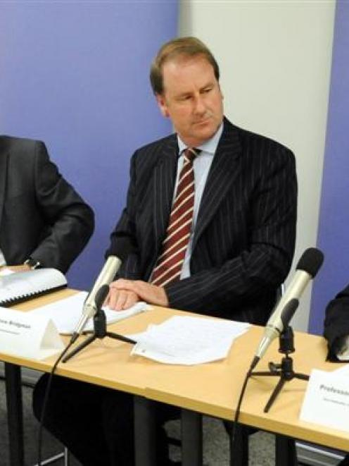 Anne Kolbe (left), Andrew Kaye, Andrew Bridgman and David Skegg release the decision on the...