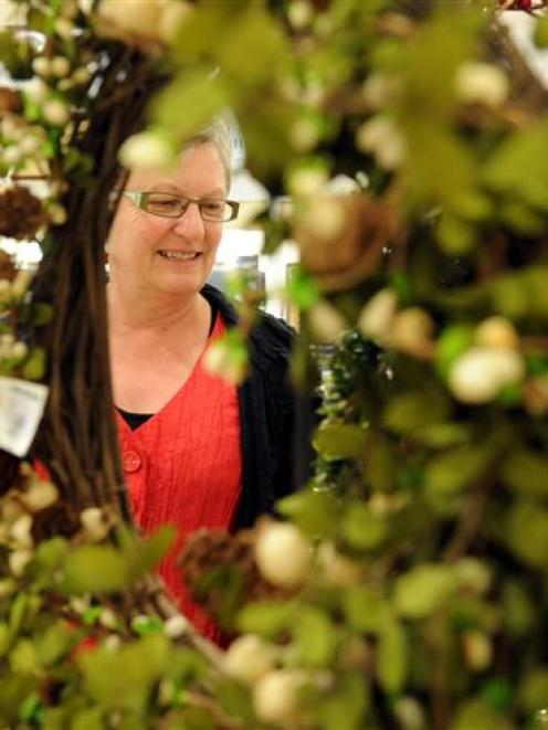 Anne Shanks, of Mosgiel, takes a moment from her busy Christmas shopping schedule to look at ...