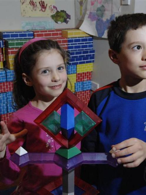 Annelise (5) and William Scharpf (8) use a complex building toy in their Dunedin home. Photo by...