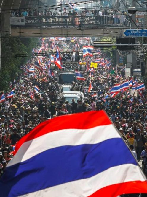 Anti-government protesters take part in a rally in central Bangkok yesterday. REUTERS/Athit...