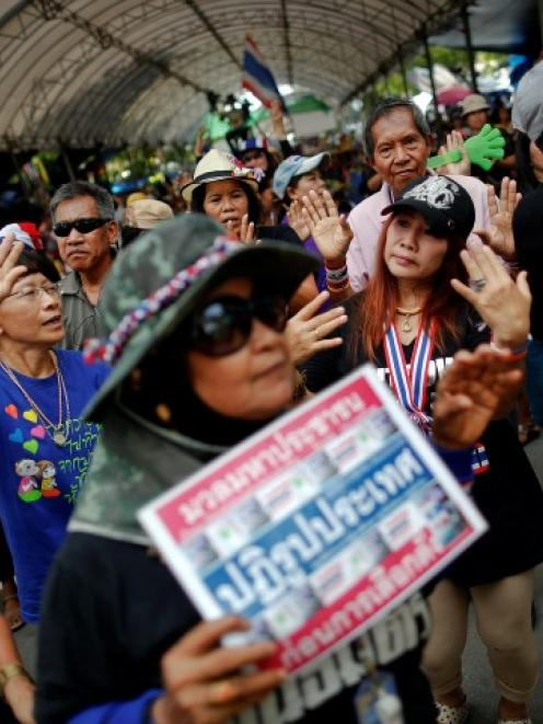 Anti-government protesters take part in a rally in an area protesters are occupying around the...