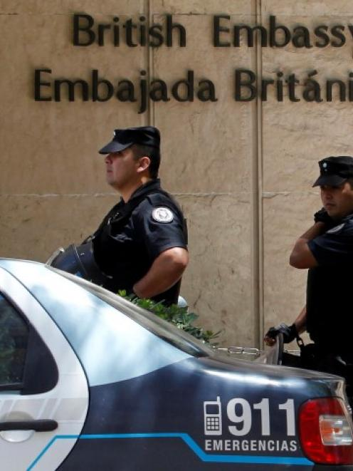 Anti-riot police stand in front of the British Embassy during a protest of Argentine Falklands...