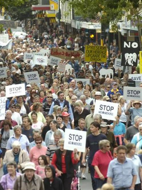 Anti-stadium demonstrators make their way way down George St today. Photo by Peter McIntosh