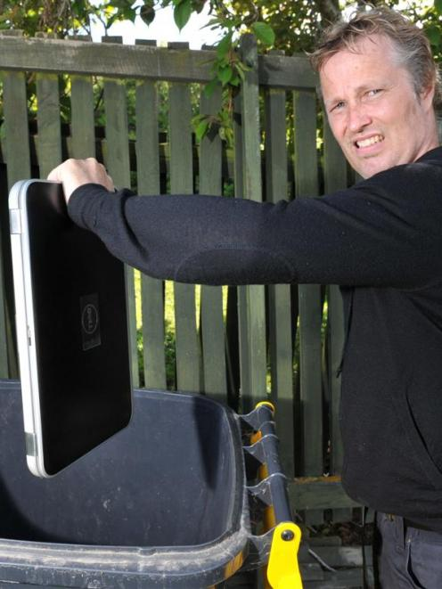 App developer Glenn Linde (44) dumps his laptop after Google closed his Android developer account...